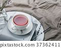 Cup of black tea on a book on the marble tray 37362411