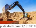 Excavator Loading Dumper Truck at sunny day 37362819