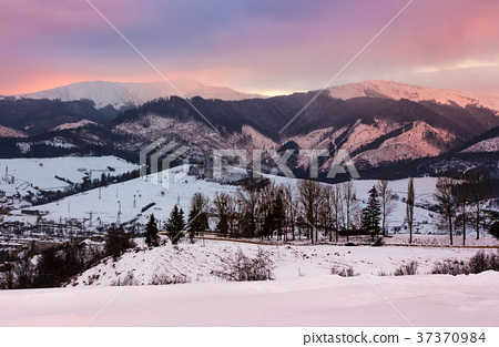 reddish winter evening over the mountains 37370984