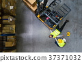 Warehouse workers after an accident in a warehouse 37371032