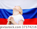 Portrait of emotional little boy with russian flag on background 37374216