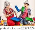 Repair home women holding bank with paint for 37374274