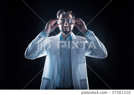 Positive cheerful scientist wearing his glasses 37381310
