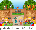 Kids playing at the zoo with zookeeper and animal 37381618