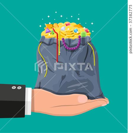Treasures in bag in hand 37382775