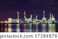 Oil refinery plant in the night light. 37384876