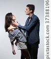 Portrait of a Teenage Couple Embracing. 37388196