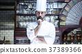 站立在餐館的廚師 37389366