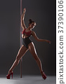 Female pole dancer 37390106
