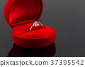 Gold diamond ring in red heart shaped velvet box  37395542