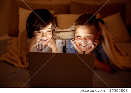 Two happy youngsters watching movie 37396898
