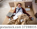 Tranquil guy sleeping in the morning at home 37398035