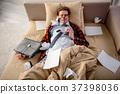 Serene man having nap on the sofa 37398036
