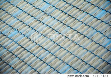 Tile roof of the house is beautifully lined. 37407183