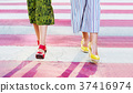 Girl walking on a street with colorful pedestrian crossing close 37416974