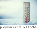Thermometer on snow shows low temperatures. 37417266