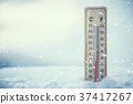 Thermometer on snow shows low temperatures. 37417267