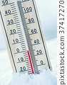 Thermometer on snow shows low temperatures. 37417270