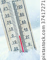 Thermometer on snow shows low temperatures. 37417271