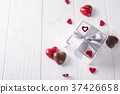 candies hearts and gift box on wooden board, 37426658