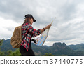 Asia woman traveler with backpack checks map  37440775