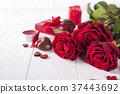 Beautiful red rose and dark chocolate for 37443692