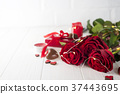 red roses and chocolate candies for Valentine's 37443695