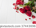 red roses and chocolate candies for Valentine's 37443696