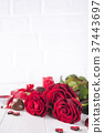 Beautiful red rose and dark chocolate for 37443697