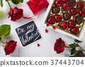 Delicious chocolate candies in gift box on white 37443704