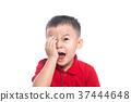 Portrait of cute smiling little boy closed one eye 37444648