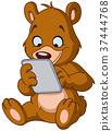 Teddy bear with tablet 37444768