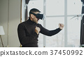 Excited young man with virtual reality headset 37450992