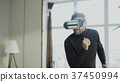 Excited young man with virtual reality headset 37450994
