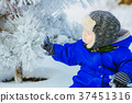 Child in the park with snow in winter 37451316