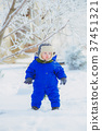 Child in the park with snow in winter 37451321