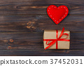 Heart and gift box with red ribbon 37452031