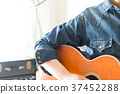 guitar, guitars, person 37452288