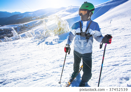 Man skier on a slope in the mountains 37452539