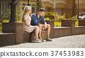 Young woman talking to jealous upset boyfriend 37453983