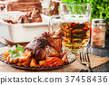 Roasted turkey knuckle with potatoes and vegetable 37458436