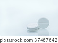 White chewable tablets on white background  37467642