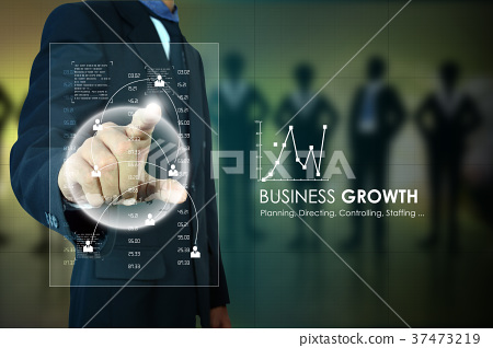 Businessman pressing virtual buttons 37473219
