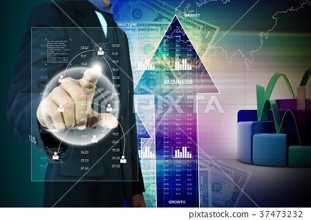 Businessman pressing virtual buttons 37473232