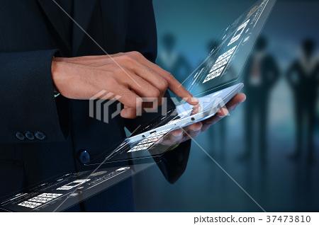 Businessman pressing virtual buttons 37473810