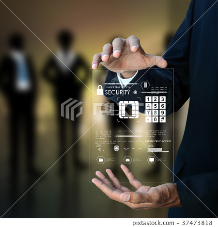 Businessman pressing virtual buttons 37473818