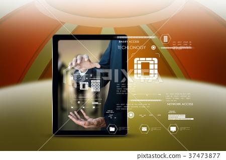 Businessman pressing virtual buttons 37473877