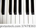 A piano keyboard taken close up. 37478363