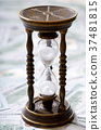 Time is money. Hourglass and us dollars 37481815