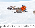 An athlete skier is jumping from high rock high in 37482215